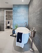 Free-standing bathtub and Champagne cooler in designer bathroom