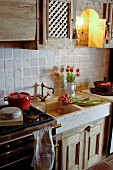Tulips in sink of rustic country-house kitchen