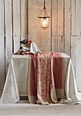 Paisley table linen against of rustic board wall