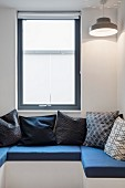 Fitted U-shaped window seat with seat cushions and scatter cushions