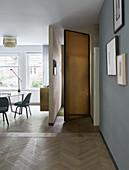 Open door to foyer behind partition wall