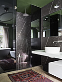 Marble walls and walk-in shower in modern bathroom