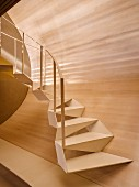 Designer steel stairway with wood-clad wall