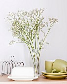 Vase of gypsophila on breakfast table