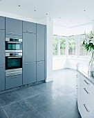 Grey fitted kitchen with corner windows