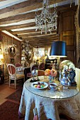 Cafe decorated with antique furniture, paintings and flea-market finds