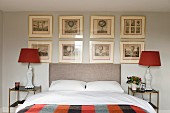 Gallery of etchings in classic bedroom