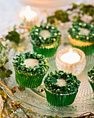 Festive cupcakes and tealight on cake plate