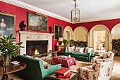 Classic living room in red and green in Cornwell Manor