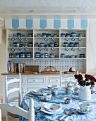 Collection of blue and white crockery in dresser in rustic kitchen