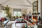 Festive English-style living room with open fireplace