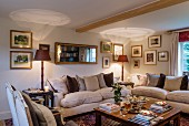 Antique mirror and collection of pictures on wall in elegant lounge area