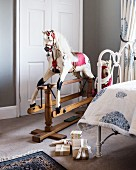 Old-fashioned rocking horse in child's bedroom