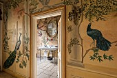 Traditional murals of birds and plants in bathroom