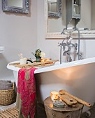 Free-standing bathtub and vintage ornaments