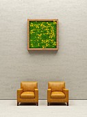 Two leather chairs below living picture frame, 3D rendering