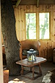 Rustic interior of tree house with tree trunk in one corner