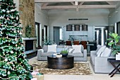 Modern living room in earth tones with Christmas tree