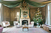 Open fireplace and festive drapery in classic lounge