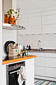 White fitted kitchen with subway wall tiles