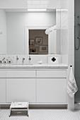 Minimalist bathroom all in white