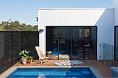 Terrace with pool and wooden deck