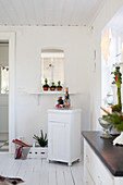 Cabinet below aperture in wall and Christmas decorations
