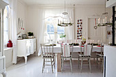 Table set for Christmas in Scandinavian dining room