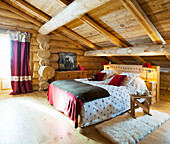 Rustic bedroom in attic of log cabin