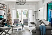 Glamorous living room in shades of gray with a Christmas tree