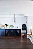 American style open plan kitchen with island and bar stools