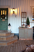 Country-house-style house entrance with rustic winter decorations