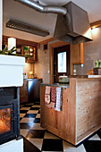 Cosy country-house kitchen with chequered floor