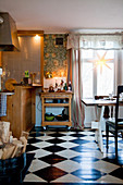 Serving trolley in cosy country-house kitchen with chequered floor