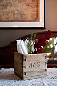 Candles and twigs in old wooden box carved with initials