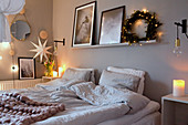 Cosy lighting and Christmas decorations in grey bedroom