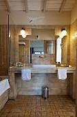 Modern washstand in rustic bathroom in shades of brown