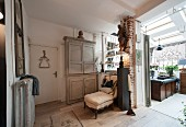 Antique furniture and skylights in renovated period apartment