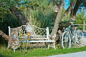 Two bicycles next to romantic metal bench