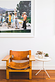 Vintage leather chair and side table under large format photo