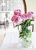Pink peonies in jar