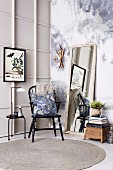 Vintage corner with Windsor chair and wall mirror in front of photo wallpaper