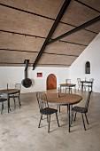 Black metal furniture in modern tasting room