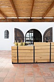 Wine tasting on roofed terrace with rustic bar