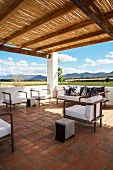 Lounge on roof terrace with shady pergola and panoramic view