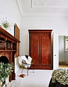 Antique wooden cupboard in the living room with stucco ceiling