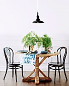 Round rustic table with black coffee house chairs