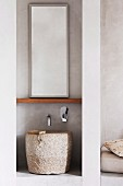 Roughly hewn stone sink under the mirror