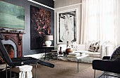 Classic fireplace and large artworks in living area
