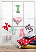 'I heart XMAS' made from fabric letters hung from lattice window